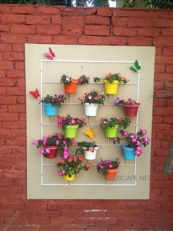 DECORATIVE DISPLAY POTS ON WALL STAND